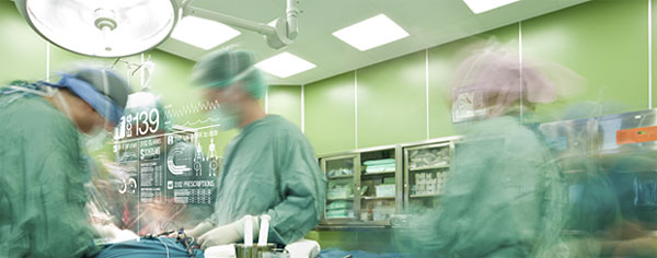 Doctors in operating room with data