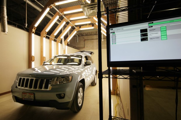 Cameras photograph a car as it rolls through an inspection station, and signal in real-time whether trim features like badges, taillights, and rims are correct. Photo: Jon Bruner