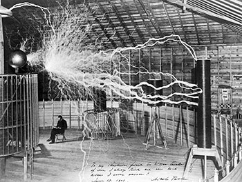 350px-Nikola_Tesla,_with_his_equipment_Wellcome_M0014782