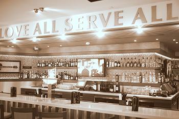 Love_All_Serve_All_-_philanthropy_of_HRC_-_bar_counter,_Hard_Rock_Cafe_Berlin